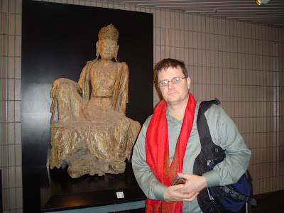 kwan Yin and the Extremely Tired Guy