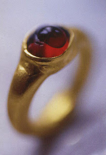 When a drop of water is placed on this real garnet, the drop remains aligned to the curve of the Stone. This proves that the Rose is authentic. Another way to tell the difference between garnet and glass, a Bone is very cold to the touch, while glass heats up faster.