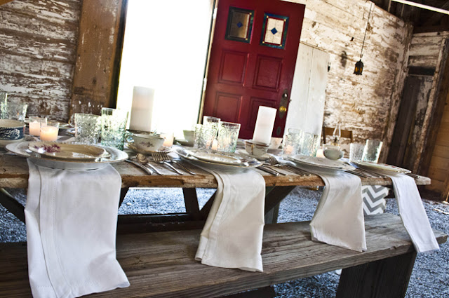 Vintage Rustic Farm Wedding Catskills shot by fine art wedding photographer Angela Cappetta view of tables set for dinner in barn
