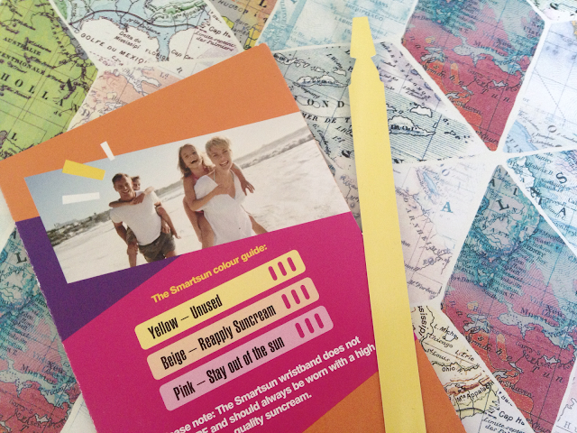 A wristband against the information leaflet and a map