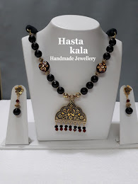 A Black colour Necklace combination of Red Colour Kundan Beads