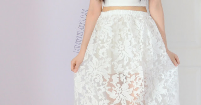 Close-up on the puffy, lace-embroidered long skirt from SheIn's two-piece all-white matching set.