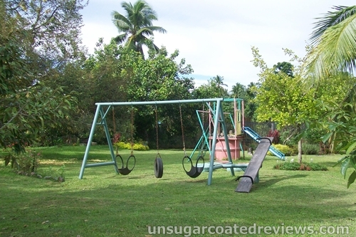 kiddie playground with swings, slide, and seesaw