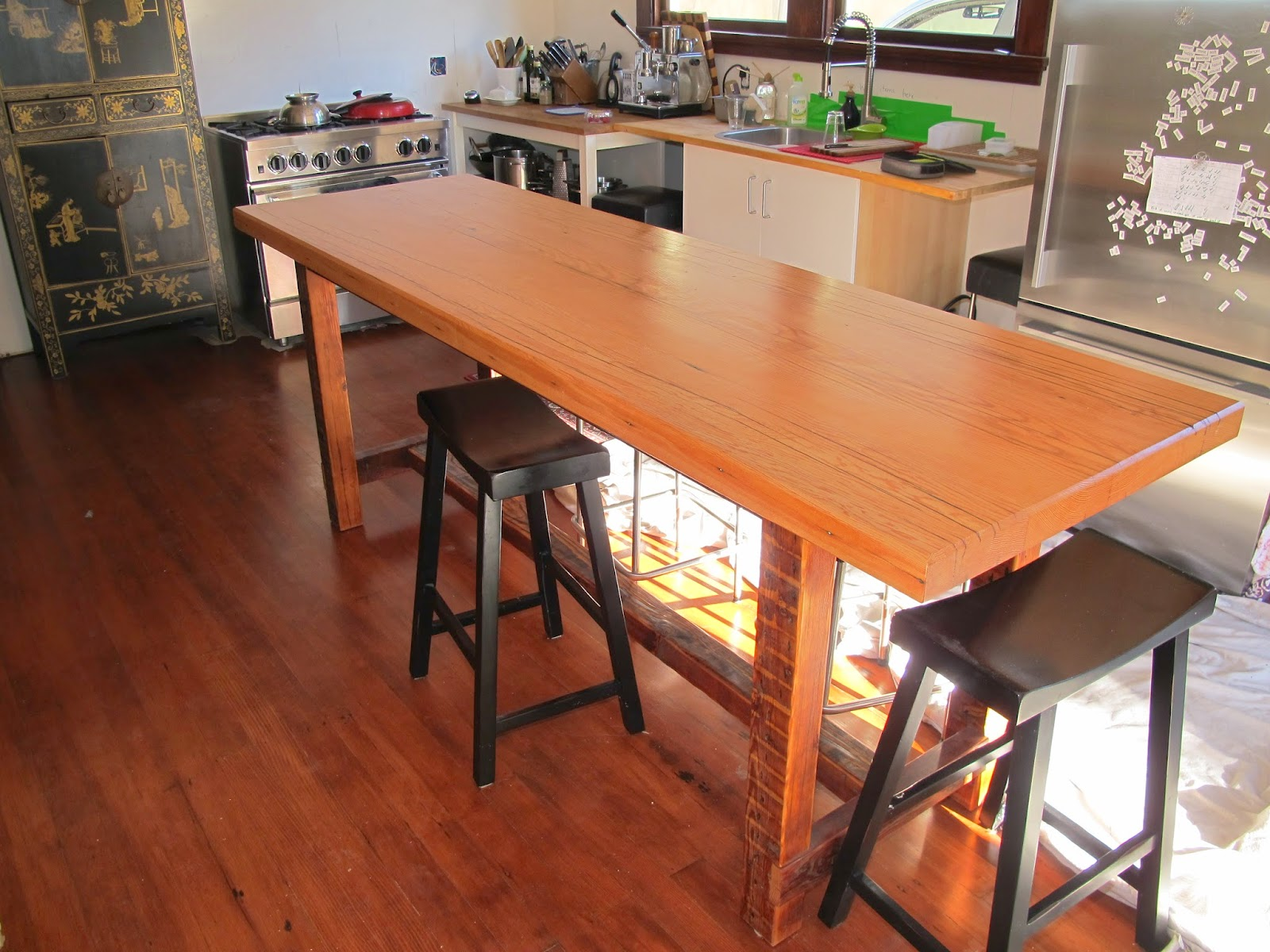 alameda dining table. the base is rough sawn doug fir very simple design, this at island ht., 36\ alameda dining table l