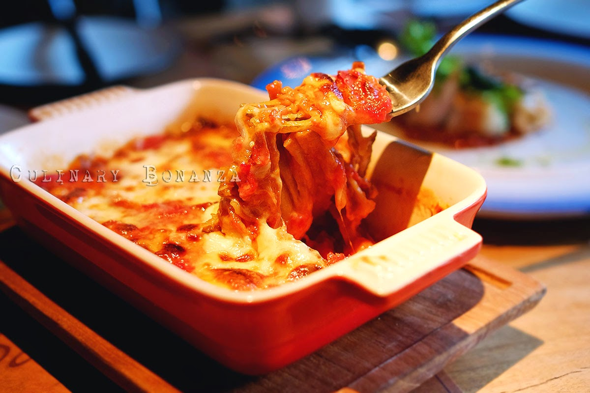 Parmigiana di Milanzane - baked eggplants, parmesan, mozzarella & tomato sauce