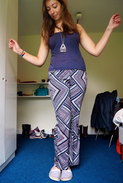 Printed Patterns | outfit of dark blue vest top, blue, purple and pink patterned trousers, and striped espadrilles