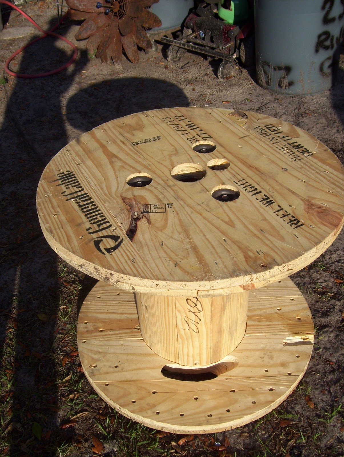 Rustic rediscovered cable spool and barrel table i have been working on turning a cable spool that mike brought home into a table they are always the perfect size a pretty well made geotapseo Image collections