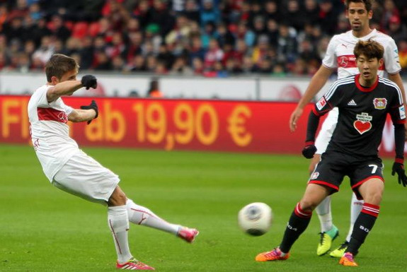 Stuttgart player Gabriele Angella shoots to score the opening goal against Leverkusen