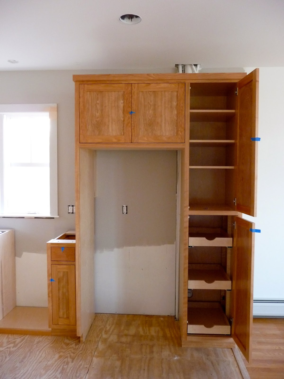 You can see how the color of the red birch cupboards change with the light  in. Skinny Cupboard