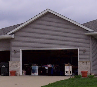 Garage with door open and items for sale inside