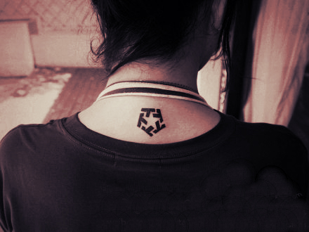 pentagon pattern tattoo below the neck