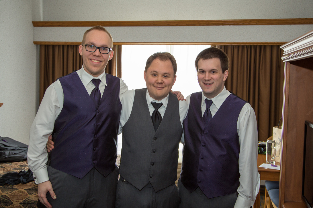 A photo of myself and my two groomsmen dressed up in our tuxedos, sans jackets.