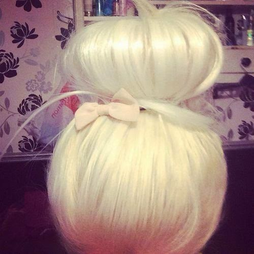 big blonde bun with a little bow of Hairs