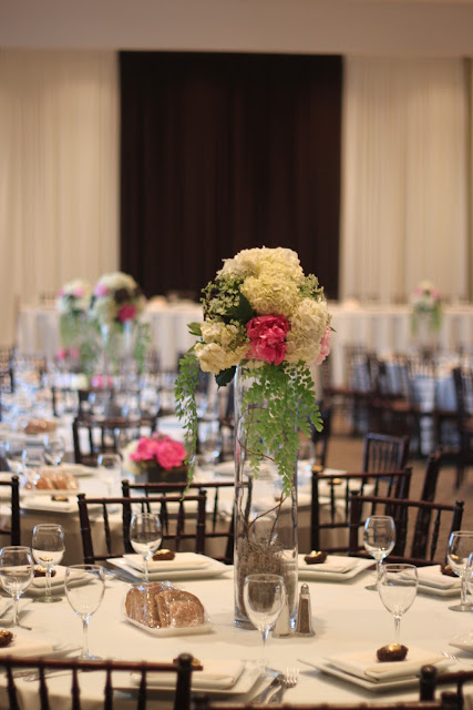long head table seating the bridal party had a gorgeous ivory and brown