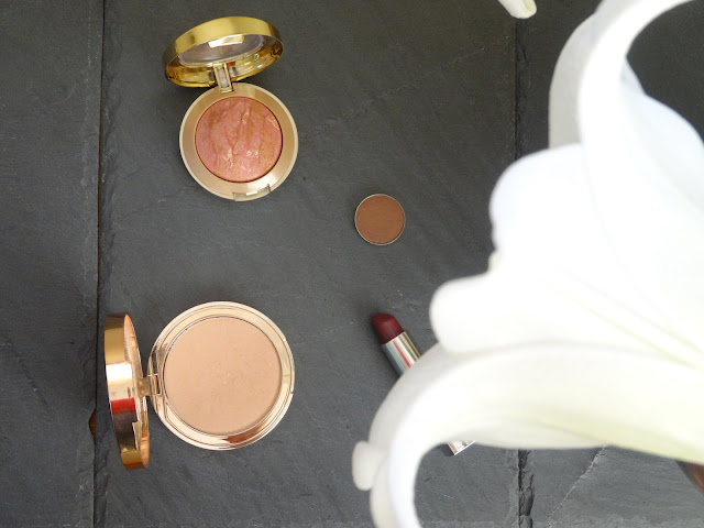 Charlotte Tilbury Norman Parkinson Dreamy Glow Illuminating Highlighter Illuminating Youth Powder, Makeup Geek Brown Sugar eyeshadow, Rimmel Moisture Sloane's Plum Lipstick, Milani Baked Busher Berry Amore