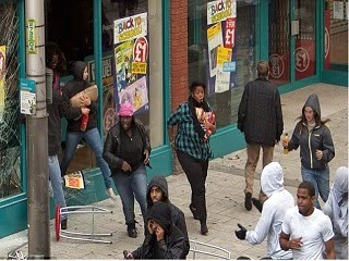 People looting a shopping center.