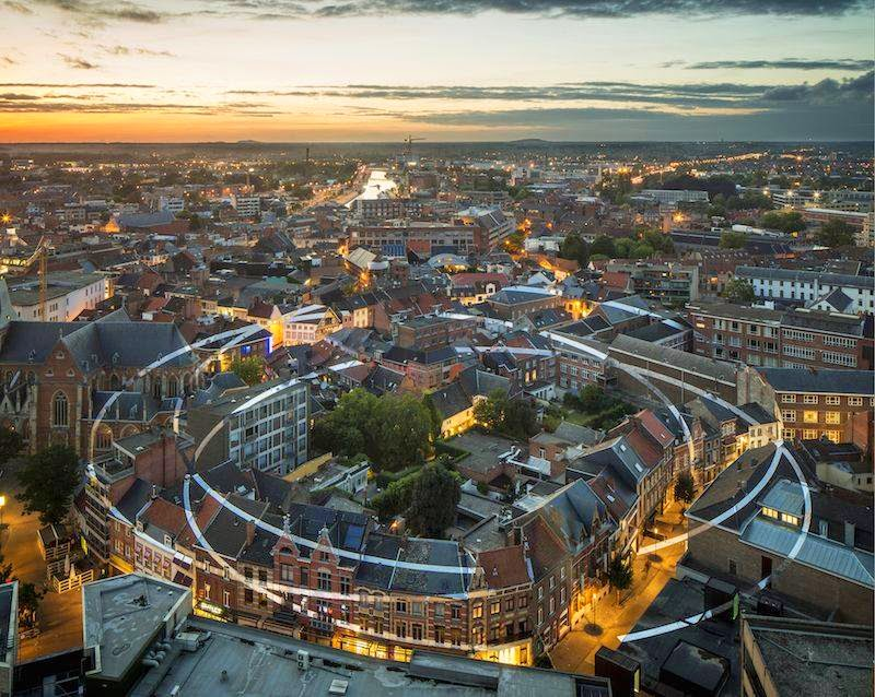 "For the ""De Unie Hasselt-Genk"" exhibition , Felice Varini realised a painting on the roofs and facades of 99 buildings in the city centre of Hasselt: 'Trois ellipses ouvertes en désordre'."