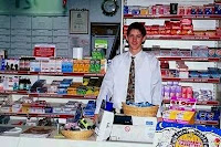 man behind the counter of a grocery store