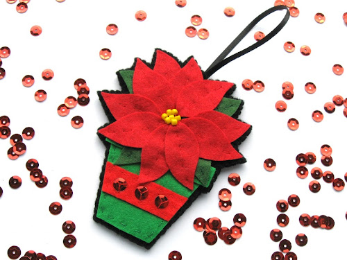 http://www.tescoliving.com/smart-living/how-to/2014/december/how-to-make-a-felt-poinsettia-bauble