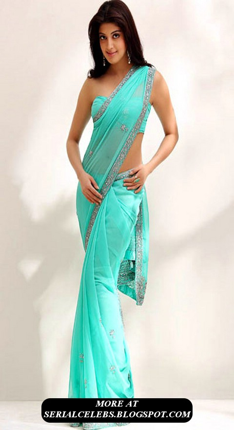 of her stills in a green low hip saree which exposes her curvy hip her ...
