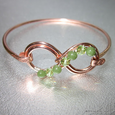 http://www.lexibutlerdesigns.com/products/gemstone-infinity-bangle