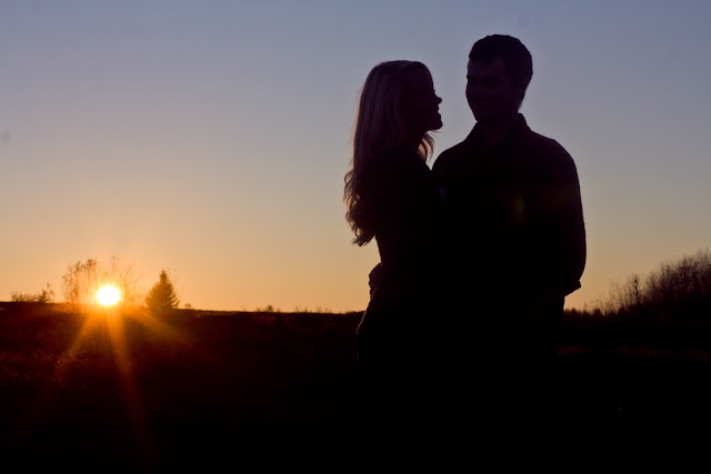 silhouette shot of couple at sunset