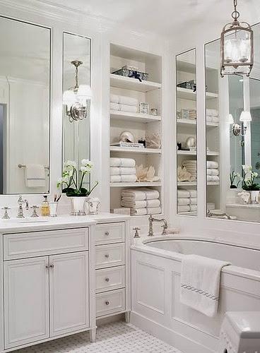 gorgeous white master bathroom paneled tub built in shelves