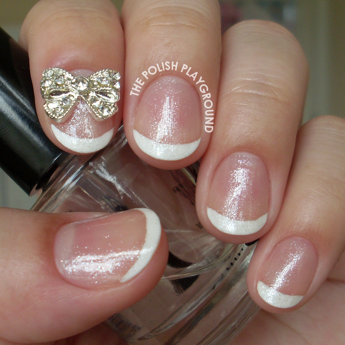 Shimmery Classic French Manicure with Bow Stud Nail Art