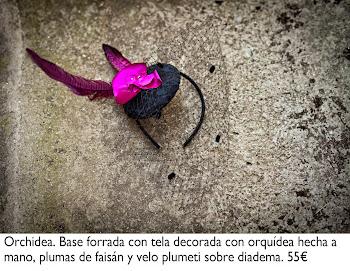 Tocado decorado con orquídea hecha a mano, plumas de faisán y velo plumeti sobre diadema