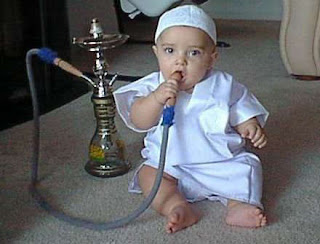 Funny Photo Funt  A funny little baby smoking a coal