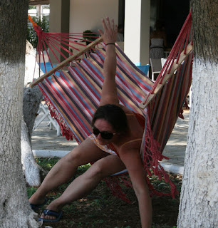 A pretending to fall out of a hammock