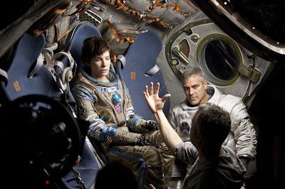 Sandra Bullock (Ryan Stone), George Clooney (Matt Kowalski) y Alfonso Cuarón