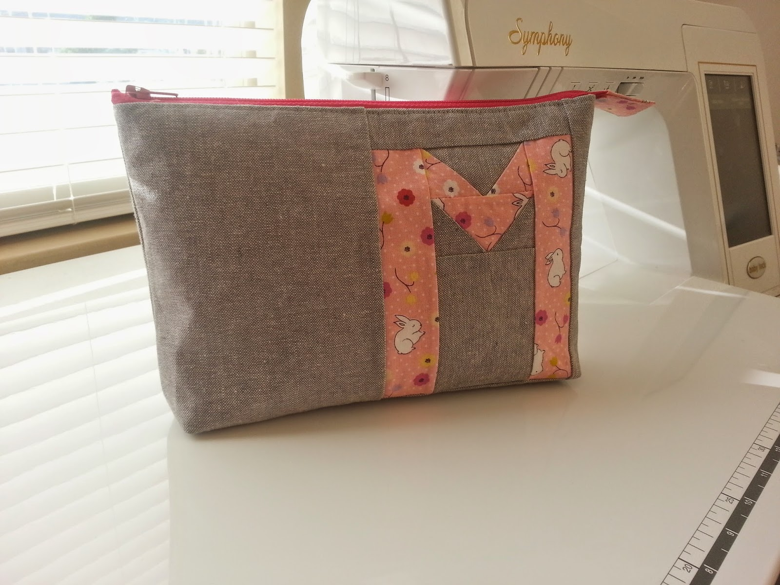 Spell it with Moda M Zippered Pouch