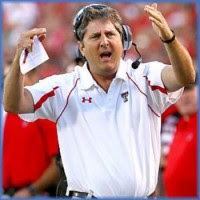 Mike Leach banned from Texas high school for pullling recruit's scholarship offer.