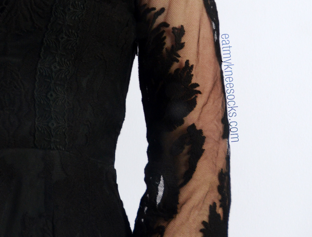 Mesh and lace detailing on SheInside's Free People-dupe black lace dress.