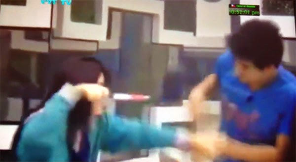 Loisa points knife at Manolo