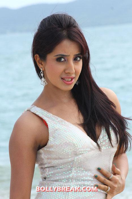 Sanjana looking ravishing in a white dress on the beach - Sanjana white dress photos on beach