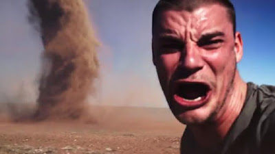 Crazy man run into tornado to take his selfie