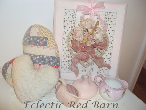 Vintage quilted hearts with framed metal heart and small pink pitchers