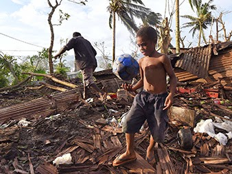 A little boy named Samuel found his soccer ball in the ruins of his family home in Port Vila, Vanuatu, after Cyclone Pam destroyed 90 percent of the city's buildings. (Credit: Dave Hunt, courtesy of AP Images) Click to Enlarge.