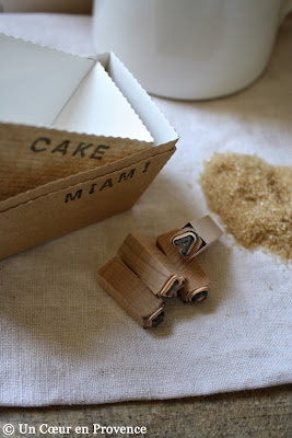 Miniature cardboard cake tins, sugar and miniature stamps
