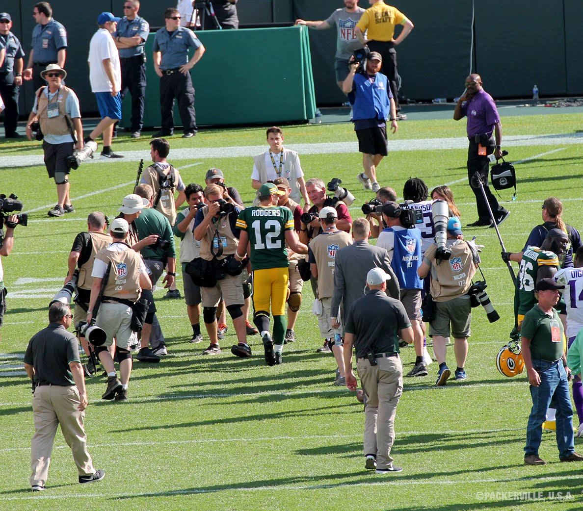 qb aaron rodgers 12 makes his way towards the tunnel after speaking with some reporters at the end of the game