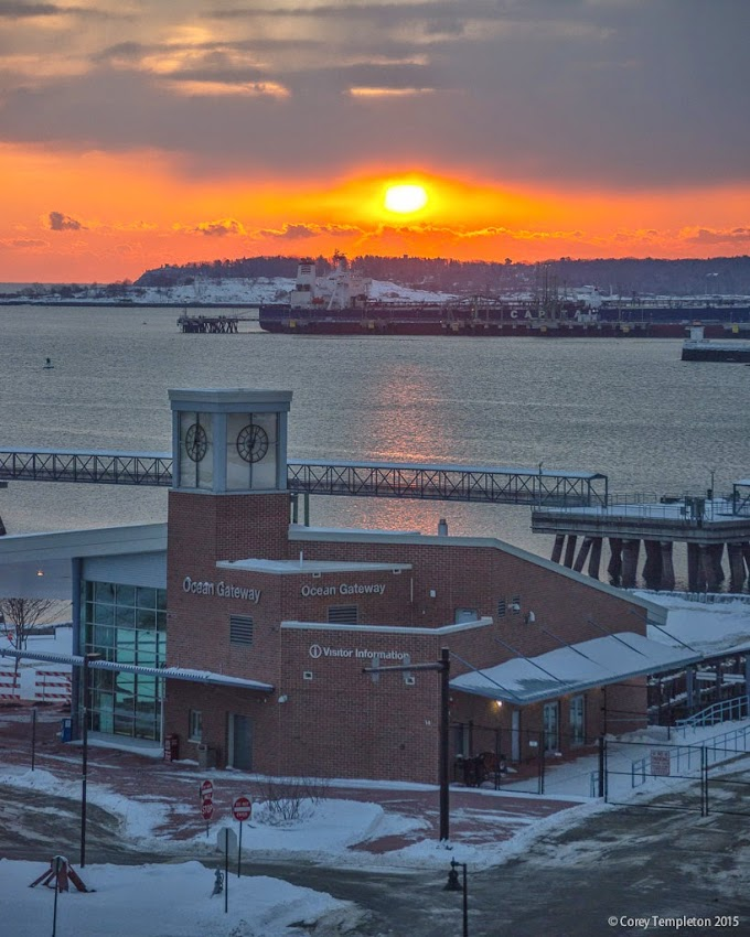 Portland, Maine February sunrise beyond Ocean Gateway over Casco Bay photo by Corey Templeton