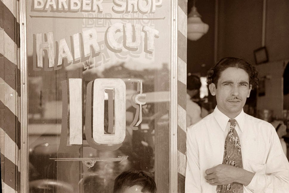 today s picture shows a barber and his shop in san antonio the picture ...