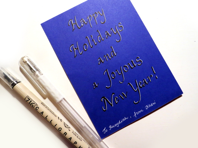 Holiday greeting written with a ZIG Calligraphy marker and highlighted with a white gel pen.