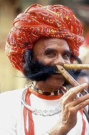 Bosco playing the nose-flute