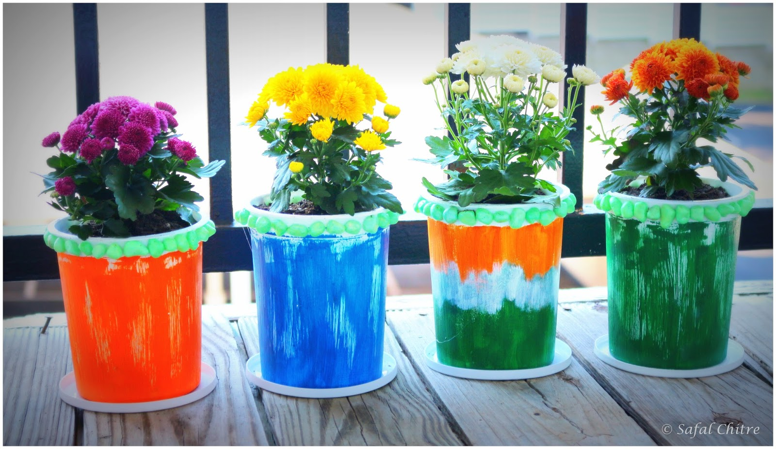 SafalArts : Recycled Art : Yogurt containers into planterns on