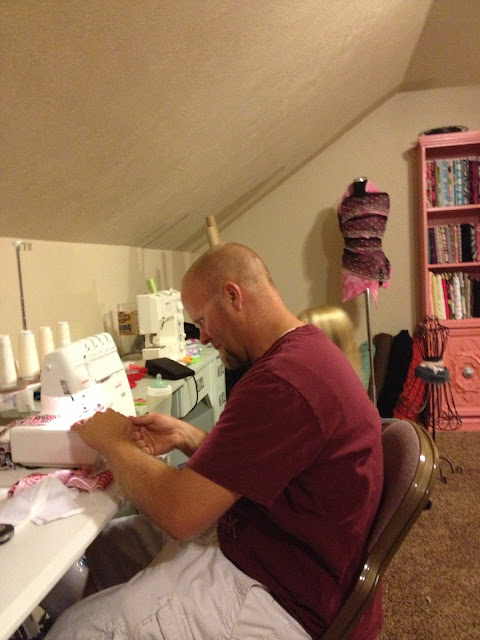 Daddy getting involved in sewing ruffle skirts