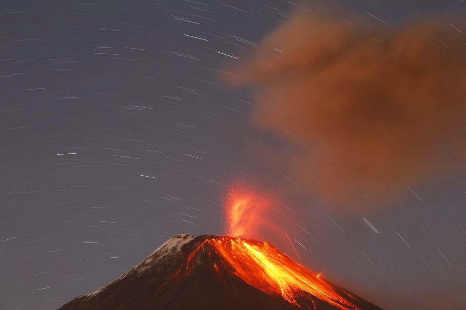 The Tungurahua volcano throws ash and stones during an eruption seen from Banos, Ecuador, Sunday, Aug. 31, 2014. The volcano entered an eruptive phase in 1999 and continues to this day.