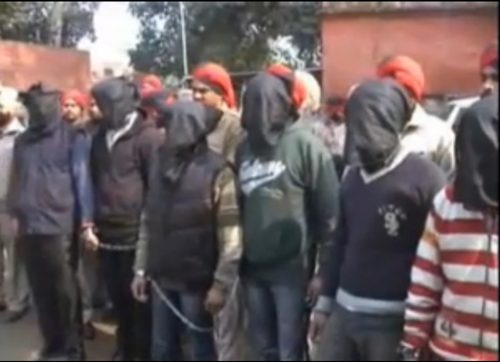 Police show the six arrested gang members covered in hoodies